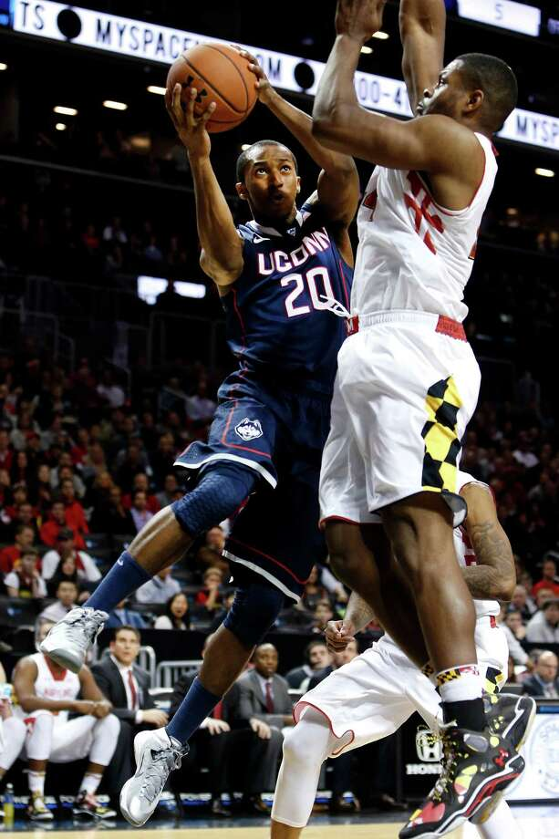 Connecticut's Lasan Kromah (20) goes to the basket against Maryland's Shaquille Cleare during the first half of an NCAA college basketball game Friday, Nov. 8, 2013, in New York. Photo: Jason DeCrow, AP / Associated Press