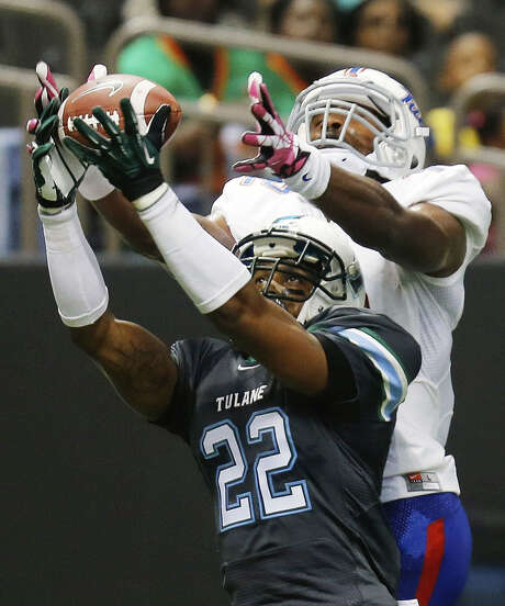 Tulane cornerback Jordan Sullen grabs one of his two interceptions on the season in front of Tulsa's Jordan James on Oct. 26. The Green Wave have picked off 16 passes this season. Photo: Bill Haber / Associated Press