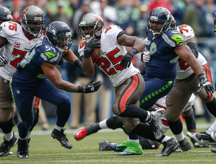 2. Emerging problems defending the runOne of the hallmarks of Seattle's stout defense this year has been its effectiveness against the run. Through the first seven games, the Seahawks had allowed opponents to average just 91.6 rushing yards per game. But that has all fallen apart in Seattle's last two outings. Two weeks ago, against the Rams in St. Louis, the Hawks allowed 200 rushing yards to rookie back Zac Stacy. Then, this past Sunday as the Seahawks looked to turn things around against winless Tampa Bay, the defense gave up 205 rushing yards to rookie back Mike James (pictured, No. 25).  Now the Seahawks are ranked just 19th in the league in run defense, giving up an average of 116.2 rushing yards per game. (Fun fact: Atlanta and Seattle are tied with the same average rushing yards allowed.) Luckily for the Hawks, however, the Falcons are the worst rushing team in the NFL, averaging a mere 64.4 yards on the ground per outing.  Atlanta's starting running back, veteran Steven Jackson, missed four games through September and October with a hamstring injury. In his return to the field last week at Carolina, he gained just 57 yards on 13 carries. While Jackson was out, backup Jacquizz Rodgers (an Oregon State product) did his best behind Atlanta's weak offensive line, yet through eight games (including four starts) has managed just 220 yards on 67 carries for an average of 3.28 yards per touch.  While the matchup certainly favors Seattle on paper, there is one big problem. Defensive end Red Bryant, largely considered the Seahawks' best player against the run, also suffered a concussion against Tampa Bay and will miss Sunday's contest in Atlanta. What's more, statistics suggested Seattle should have stuffed the Rams' and Buccaneers' running attacks -- particularly facing rookie backs -- but the Hawks got pushed around for 200 or more yards in each game. Watch Seattle's run defense closely on Sunday to see whether the Seahawks have made the appropriate adjus Photo: Ot