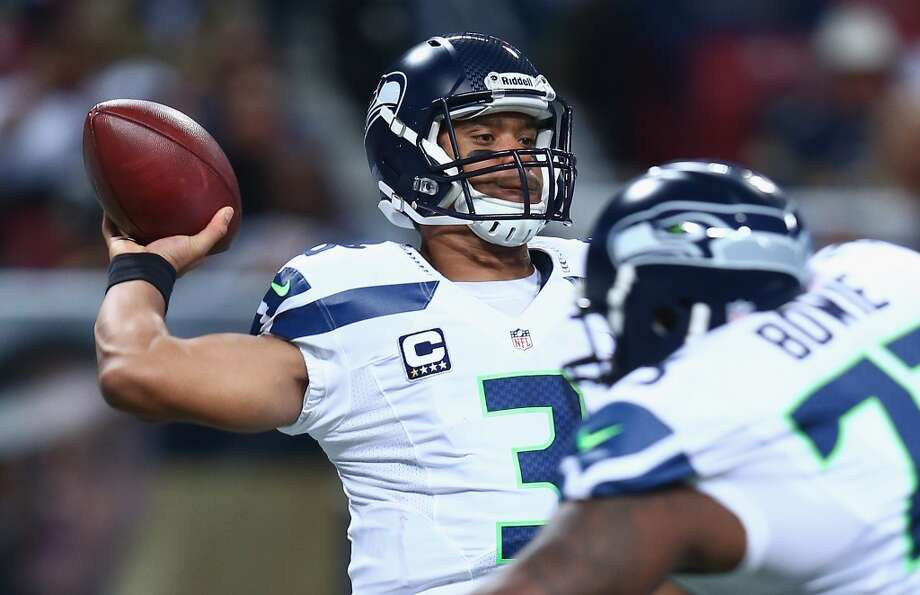 3. Who will step up for Sidney Rice?  Seattle's offense starts with the running game, but they need a strong passing game as well for everything to click. Thanks to their injury-gutted offensive line, however, the Wilson and the Seahawks have struggled to establish an air attack all season. In fact, they are ranked 27th in the league with just 200.8 passing yards per game. Their best performance came Sept. 22 against Jacksonville, when the Hawks tallied 323 passing yards, but twice this season they have managed just 91 yards through the air (against Houston and St. Louis).   Lynch seems to be back on track; he rushed for 125 yards last Sunday against the Buccaneers. Yet his Skittles-fueled game could be even better if  Seattle can take the pressure off of him with a legitimate passing threat. It all starts with the offensive line and its ability to protect Wilson in the pocket. But through nine games already, we've seen Wilson getting forced out of the pocket more often than not.  The Seahawks are also still without a No. 1 wide receiver. Despite his ho-hum numbers, Sidney Rice left a big hole in Seattle's passing attack when he suffered a season-ending ACL tear against the Rams on Oct. 28. With Percy Harvin still recovering from his preseason hip surgery, the Hawks must rely on their other receivers to step up. Golden Tate, Doug Baldwin and Jermaine Kearse have shown lots of great skill so far this season, but none of them has been the consistent play-maker Seattle needs on offense.  Roster newcomers Ricardo Lockette and Bryan Walters provide some depth in the receiving corps, and Seattle often sends its tight ends out on routes, but the Hawks are still looking for an answer when it comes to the passing game. One may not come until the offensive line is healthy again. But in the meantime, keep an eye on whether Wilson and the Seahawks can establish a true passing threat Sunday against the Falcons. Photo: Andy Lyons, Getty Images