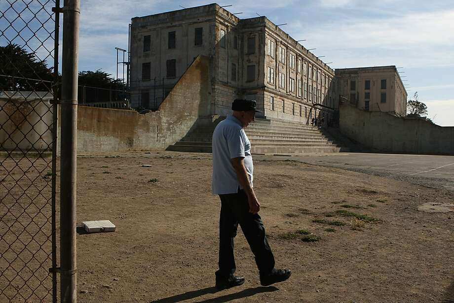 Bill Baker strolls around Alcatraz. He spent four years there locked up and learned to counterfeit checks. Photo: Liz Hafalia, The Chronicle
