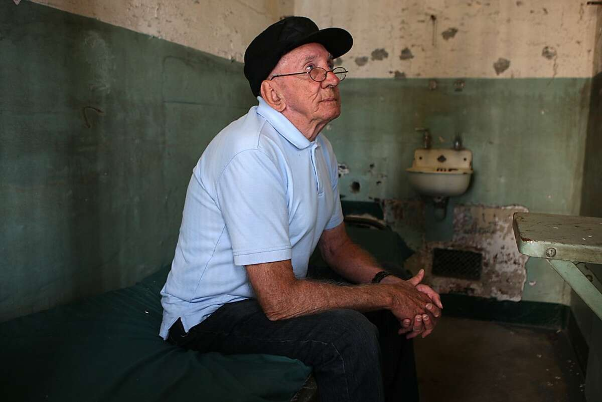 Former prisoner Bill Baker, 80 years old, talks about his book in his former cell on Alcatraz in San Francisco, California on Thursday, November 7, 2013. He studied counterfeit check cashing on the rock and made it his life's work after leaving Alcatraz. Still on parole, he has written about his experiences at the prison in the book 'Alcatraz-1259'.