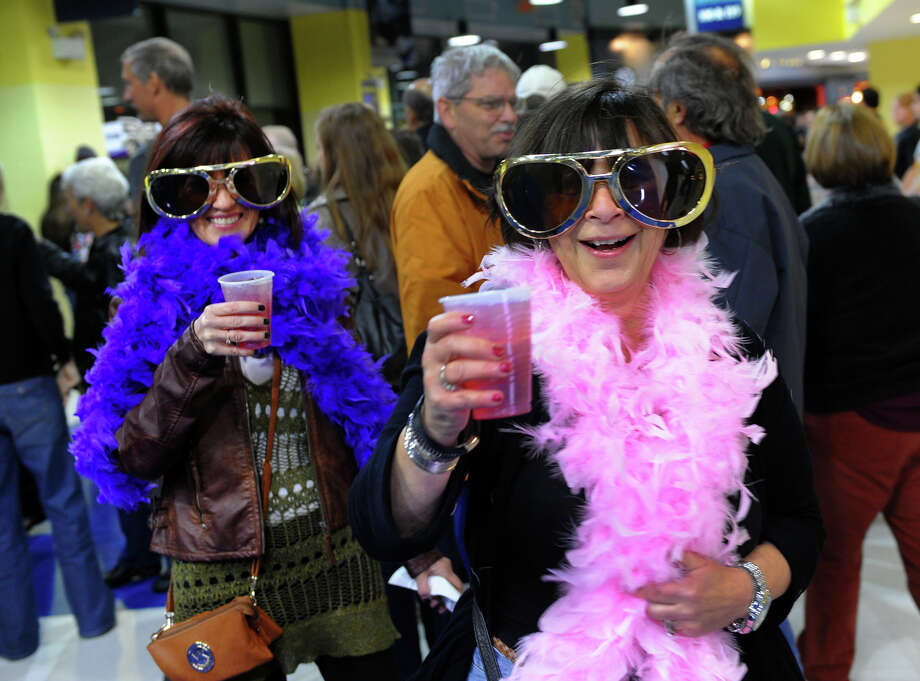 Patti Verni, left, of Branford, and Lynne LaRock, of Milford, get into the spirit before going in to watch Sir Elton John perform in concert at the Webster Bank Arena in downtown Bridgeport, Conn. on Friday November 8, 2013. Photo: Christian Abraham / Connecticut Post