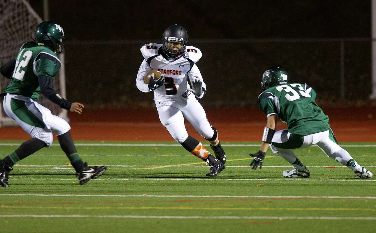Stamford's Cameron Webb carries the ball during Friday's football game in Norwalk, Conn., on November 8, 2013.
