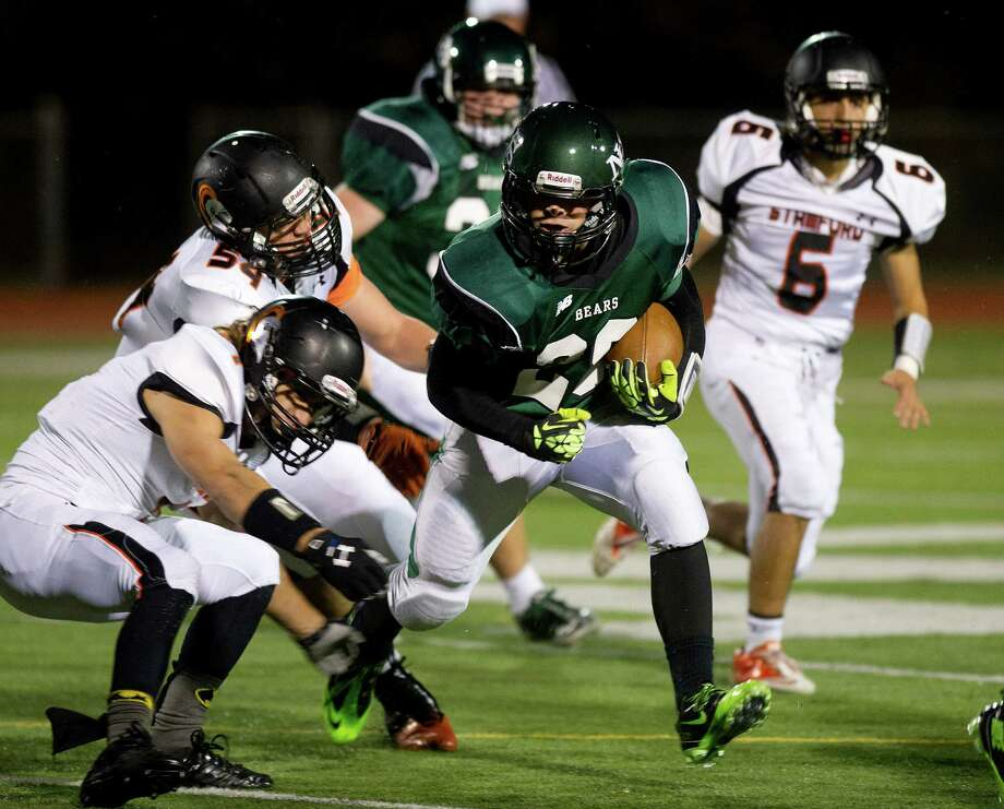 Norwalk's Joey Laracca carries the ball during Friday's football game in Norwalk, Conn., on November 8, 2013. Photo: Lindsay Perry / Stamford Advocate