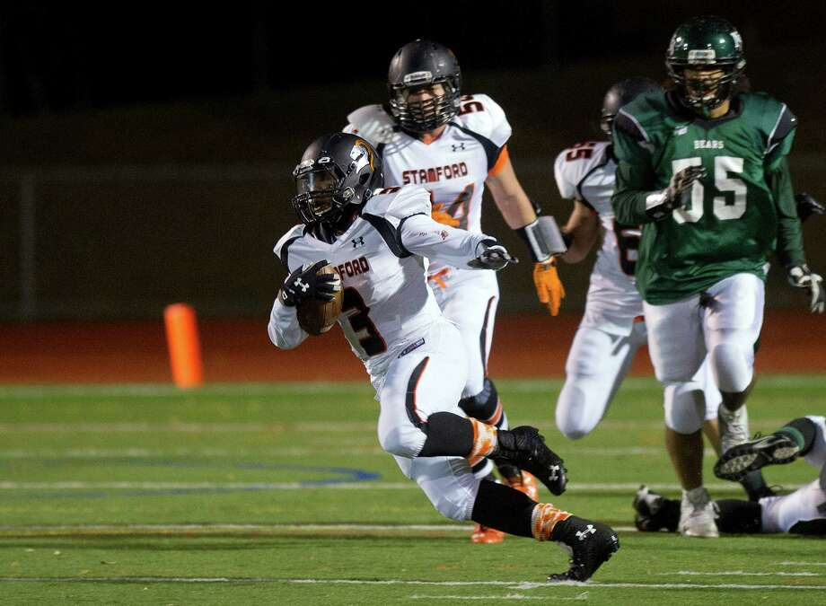 Stamford's Cameron Webb carries the ball during Friday's football game in Norwalk, Conn., on November 8, 2013. Photo: Lindsay Perry / Stamford Advocate