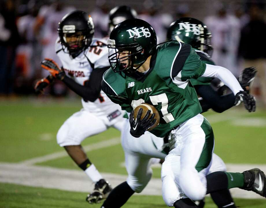 Friday's football game against Stamford High School in Norwalk, Conn., on November 8, 2013. Photo: Lindsay Perry / Stamford Advocate
