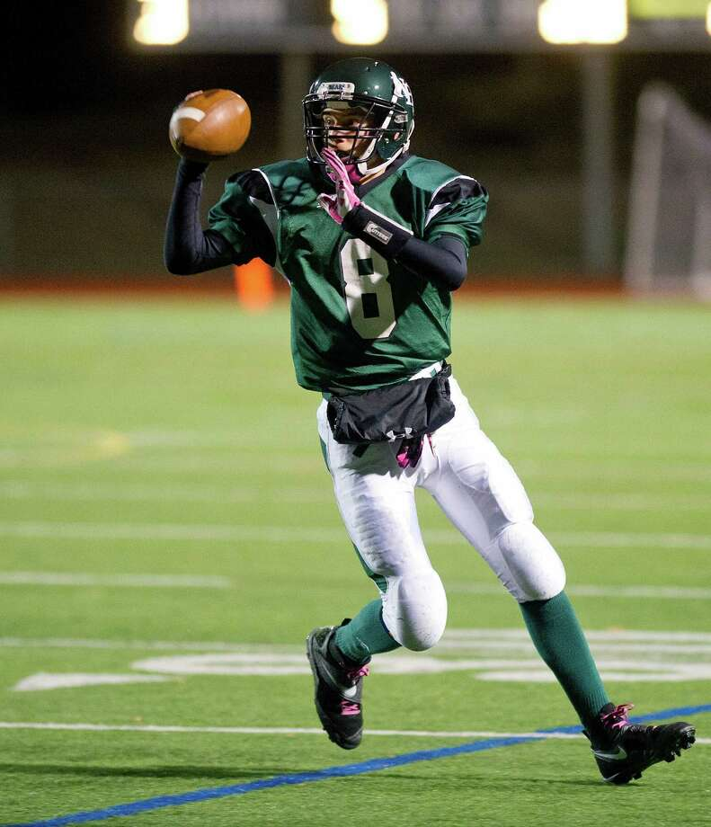 Norwalk's Andrew Huzina throws a pass during Friday's football game in Norwalk, Conn., on November 8, 2013. Photo: Lindsay Perry / Stamford Advocate