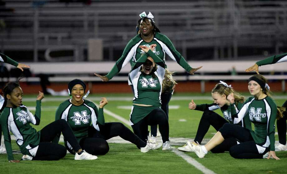 Norwalk High School's cheerleaders perform during Friday's football game in Norwalk, Conn., on November 8, 2013. Photo: Lindsay Perry / Stamford Advocate