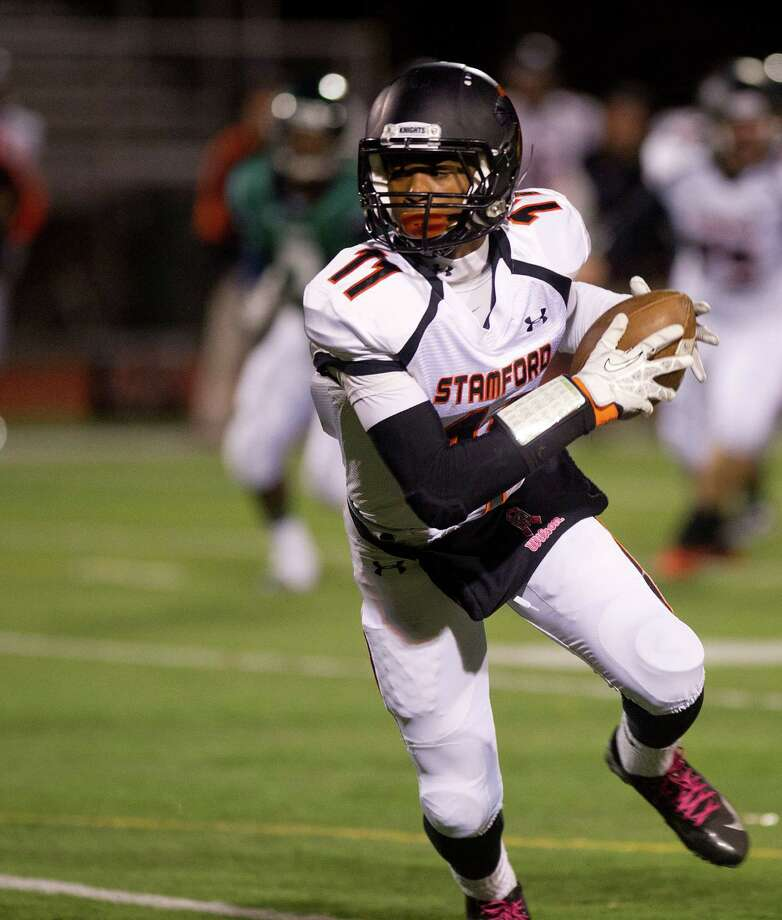 Stamford's Andrew Antoine carries the ball during Friday's football game in Norwalk, Conn., on November 8, 2013. Photo: Lindsay Perry / Stamford Advocate
