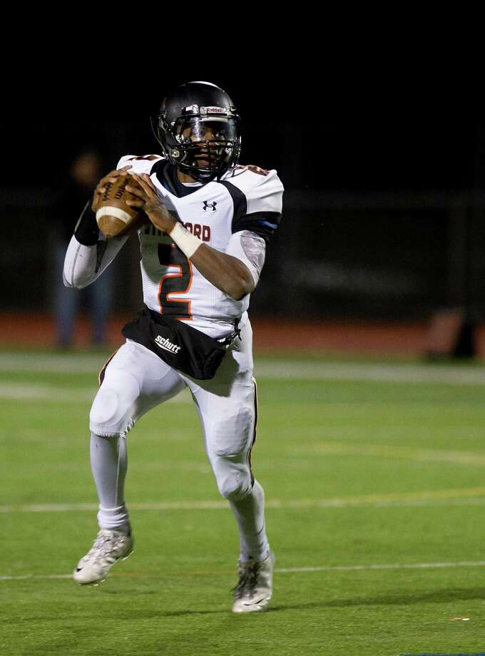 Stamford's Jalen Brown throws a pass during Friday's football game in Norwalk, Conn., on November 8, 2013. Photo: Lindsay Perry / Stamford Advocate
