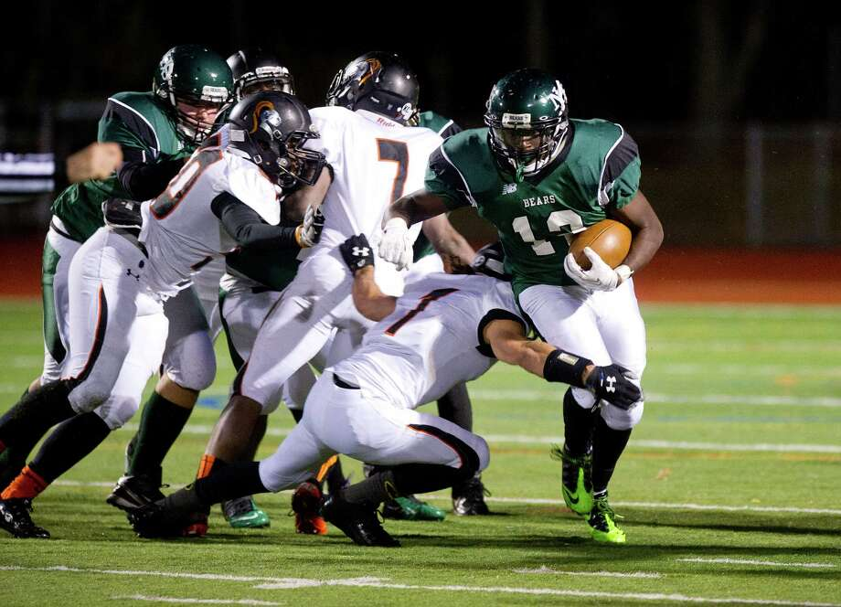 Norwalk's Clifford Joseph carries the ball during Friday's football game in Norwalk, Conn., on November 8, 2013. Photo: Lindsay Perry / Stamford Advocate