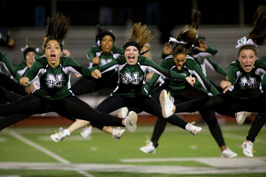 Norwalk High School's cheerleaders perform during Friday's football game in Norwalk, Conn., on November 8, 2013. Photo: Lindsay Perry / Stamford Advocate