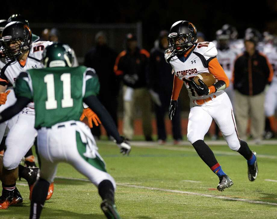 Stamford's Chris Durant carries the ball during Friday's football game in Norwalk, Conn., on November 8, 2013. Photo: Lindsay Perry / Stamford Advocate