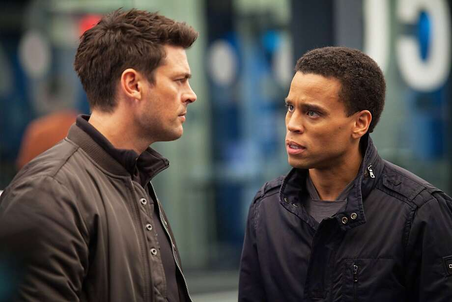 "A cop who is part machine (Karl Urban, left) is teamed up with a robot who is part human (Michael Ealy) in ""Almost Human."""