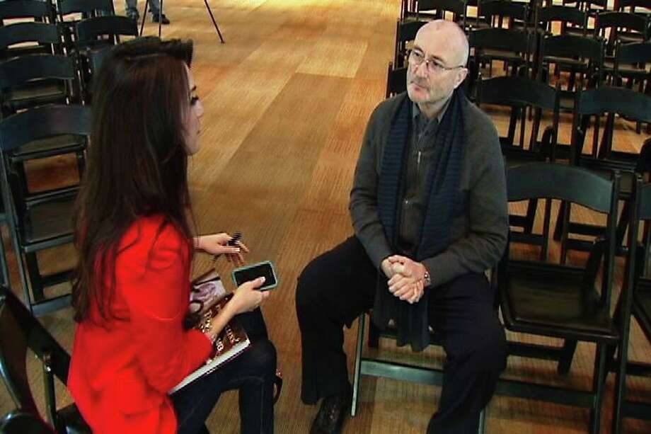 Isis Romero, sporting her former longer 'do, interviews Phil Collins. Photo: Courtesy