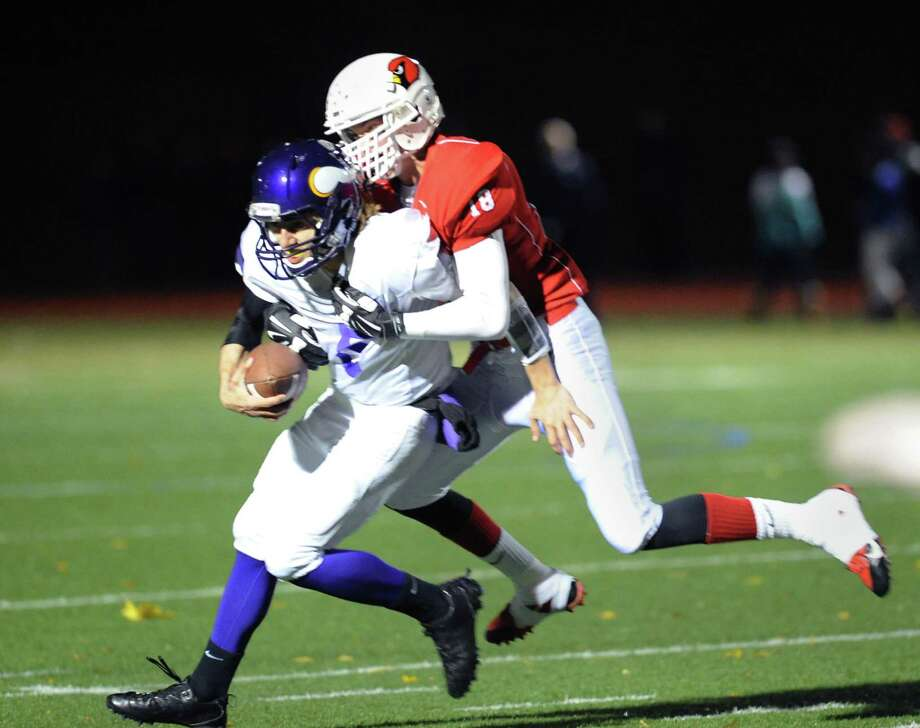 Westhill quarterback Ryan Coppola (# 5), left, is sacked by Jon Fischer (# 18) of Greenwich during the second quarter of the high school football game between Greenwich High School and Westhill High School at Greenwich, Friday, Nov. 8, 2013. Photo: Bob Luckey / Greenwich Time