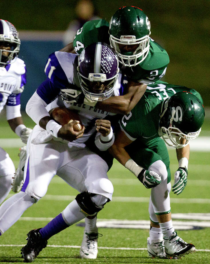 Stratford High School's Zach Miller, center, and Greg Lee right, take down Ridge Point High School's Troy Alexander during the first quarter of a football game at Darrell Tull Stadium, Friday, Nov. 8, 2013, in Houston. Photo: Cody Duty, Houston Chronicle / © 2013 Houston Chronicle