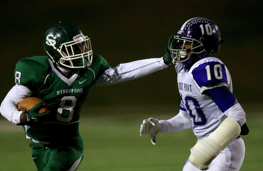 Stratford High School's Terrance Peters stiff arms Ridge Point High School's Jordan Tolbert during the second quarter of a football game at Darrell Tull Stadium, Friday, Nov. 8, 2013, in Houston. Photo: Cody Duty, Houston Chronicle / © 2013 Houston Chronicle