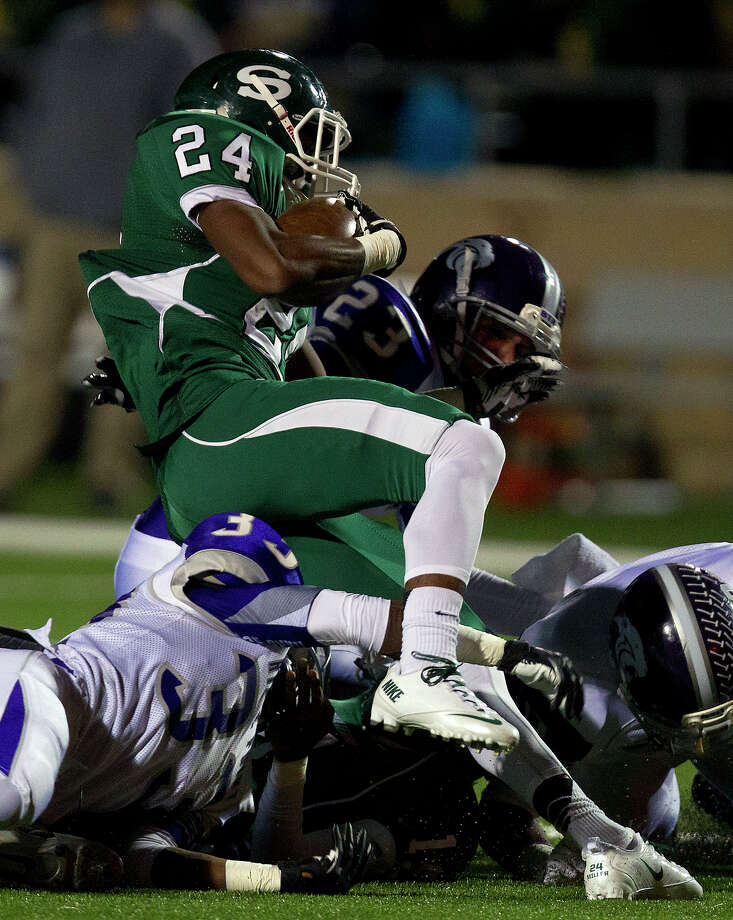 Stratford High School's Rakeem Boyd is brought down by a host of Ridge Point High School defenders during the first quarter of a football game at Darrell Tull Stadium, Friday, Nov. 8, 2013, in Houston. Photo: Cody Duty, Houston Chronicle / © 2013 Houston Chronicle