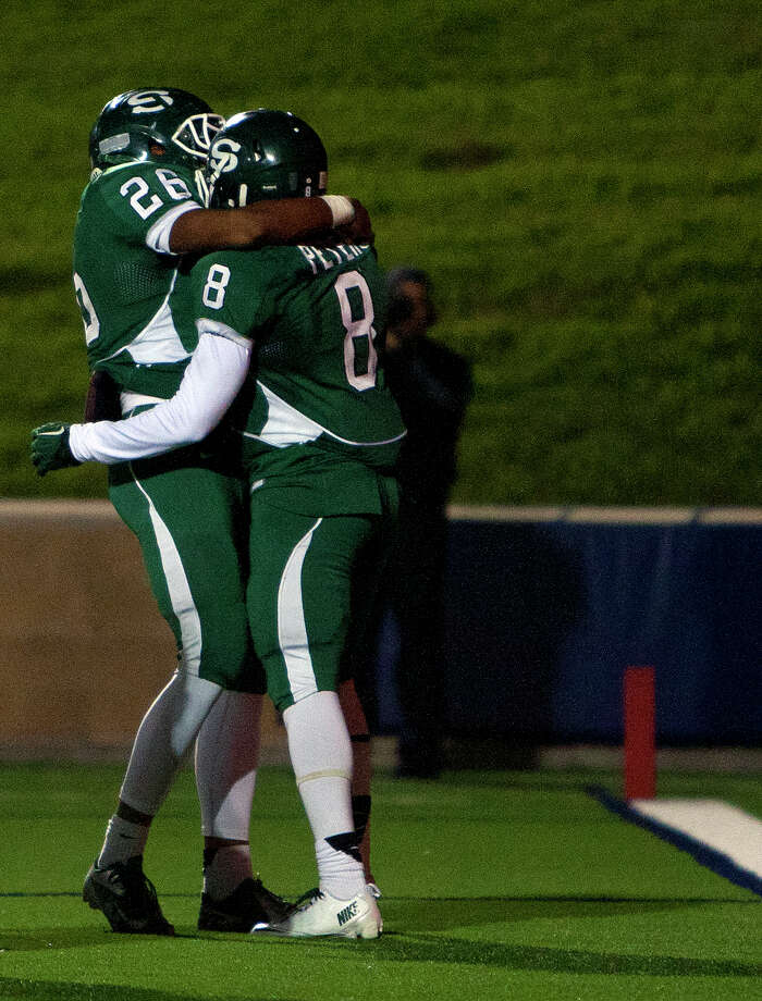 Stratford High School's Rakeem Boyd, left, and Terrance Peters celebrate after Peters scored a touchdown during the second quarter of a football game against Ridge Point High School at Darrell Tull Stadium, Friday, Nov. 8, 2013, in Houston. Photo: Cody Duty, Houston Chronicle / © 2013 Houston Chronicle