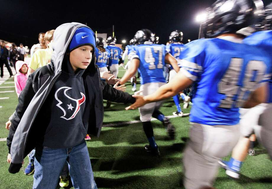 Caden Lockler, 10, welcomes the Clear Springs Chargers onto the field as they prepare to face off against the Clear Brook Wildcats at CCISD Veterans Stadium on Friday, Nov. 8, 2013, in League City. Photo: J. Patric Schneider, For The Chronicle / © 2013 Houston Chronicle