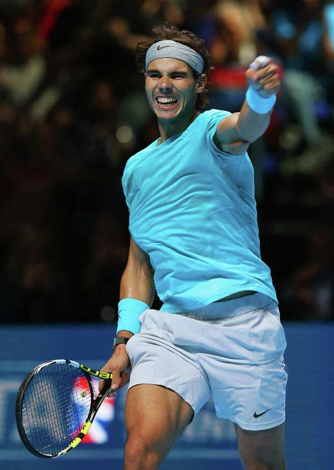 LONDON, ENGLAND - NOVEMBER 08:  Rafael Nadal of Spain celebrates victory in his men's singles match against Tomas Berdych of the Czech Republic during day five of the Barclays ATP World Tour Finals at O2 Arena on November 8, 2013 in London, England.  (Photo by Clive Brunskill/Getty Images) ORG XMIT: 181927977 Photo: Clive Brunskill / 2013 Getty Images