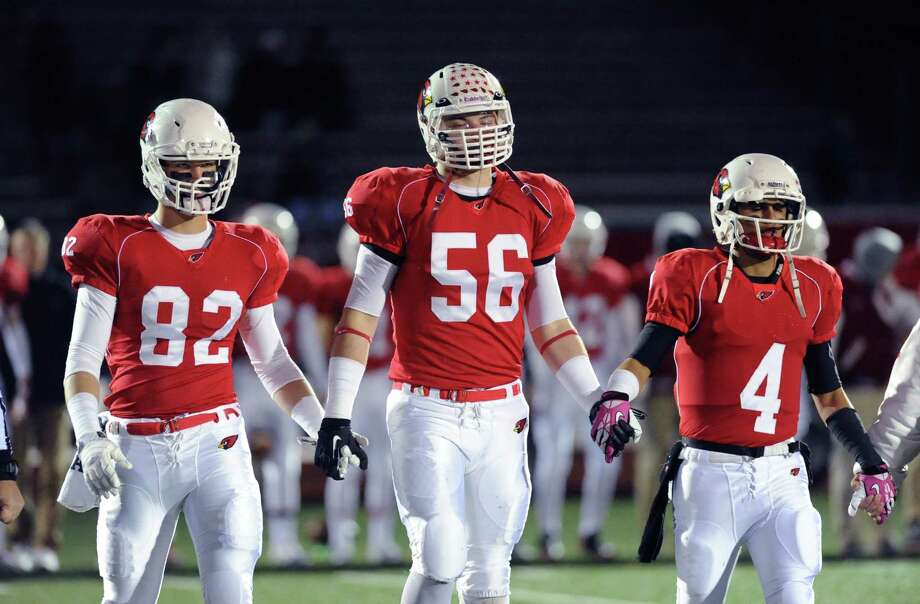 Greenwich captains from left, Jack Harrington (# 82), Jack Wynne (# 56) and Jose Melo (# 4) during the high school football game between Greenwich High School and Westhill High School at Greenwich, Friday, Nov. 8, 2013. Photo: Bob Luckey / Greenwich Time