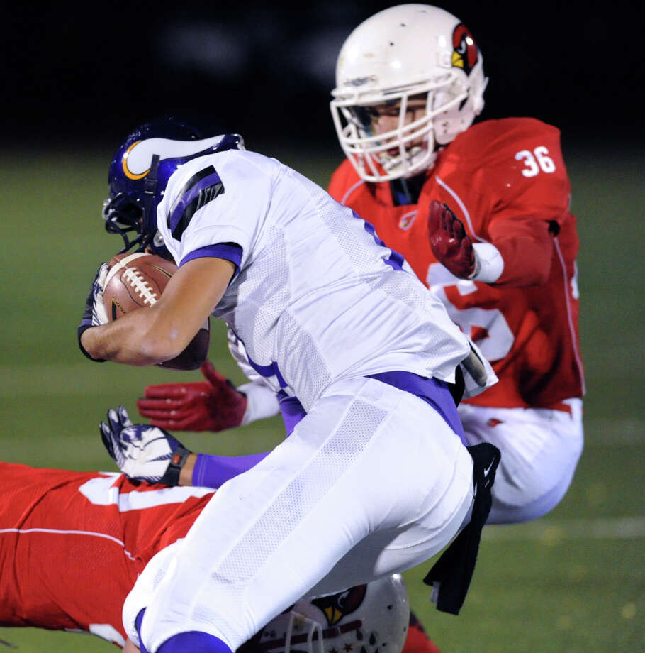 Jimmy Piotzkowski (# 36) of Greenwich goes to take down a Westhill runner Evan Skoparantzos (# 11) during the high school football game between Greenwich High School and Westhill High School at Greenwich, Friday, Nov. 8, 2013. At bottom is Griffin Tiedy (# 40) of Greenwich. Photo: Bob Luckey / Greenwich Time