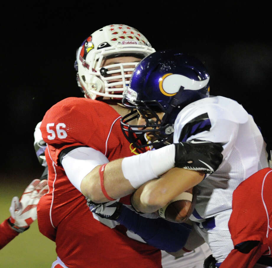 Jack Wynne (# 56) of Greenwich tackles a Westhill runner during the high school football game between Greenwich High School and Westhill High School at Greenwich, Friday, Nov. 8, 2013. Photo: Bob Luckey / Greenwich Time