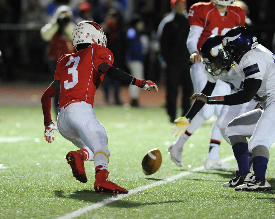 Austin Longi (#3) of Greenwich goes to recover a fumble during the first quarter of the high school football game between Greenwich High School and Westhill High School at Greenwich, Friday, Nov. 8, 2013. Photo: Bob Luckey / Greenwich Time