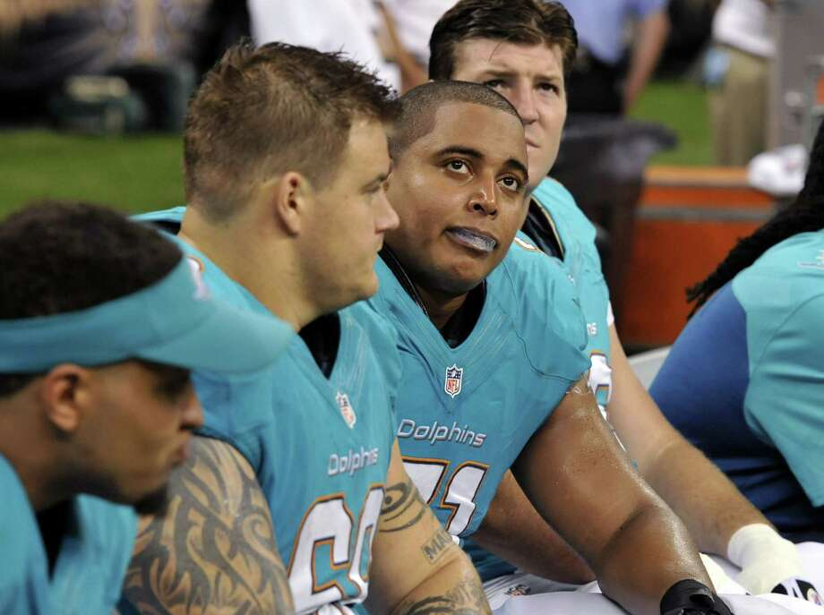 FILE - In this Sept. 30, 2013 file photo, Miami Dolphins guard Richie Incognito (68), center left, and  and tackle Jonathan Martin (71), center right, sit on the bench in the second half of an NFL football game against the New Orleans Saints in New Orleans. About halfway between the start of exhibition games and the Super Bowl, there have been plenty of unwanted story lines. Bullying in the locker room, coaches collapsing, serious injuries to marquee players, the D.C. Council's call on Washington's pro football team to change its name _ examples from the past week alone. (AP Photo/Bill Feig, File) ORG XMIT: NY169 Photo: Bill Feig / FR44286 AP