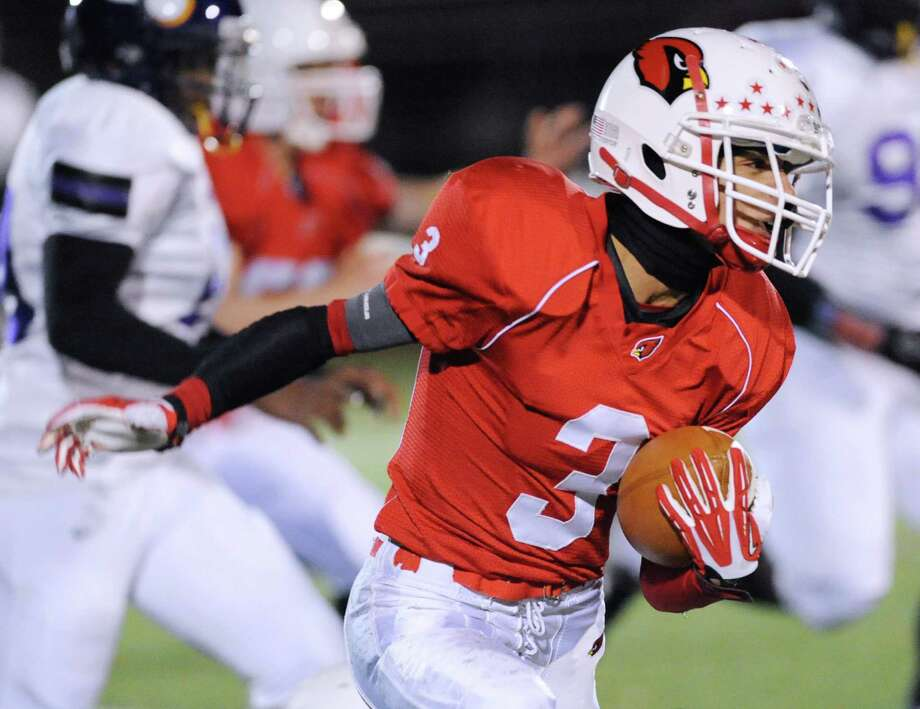 Austin Longi (#3) of Greenwich runs the ball during the first quarter of the high school football game between Greenwich High School and Westhill High School at Greenwich, Friday, Nov. 8, 2013. Photo: Bob Luckey / Greenwich Time