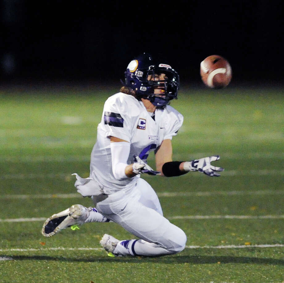 Wide receiver Dante Fargnoli (# 8) of Westhill makes a reception during the high school football game between Greenwich High School and Westhill High School at Greenwich, Friday, Nov. 8, 2013. Photo: Bob Luckey / Greenwich Time