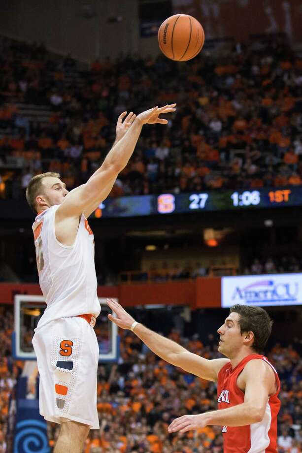 SYRACUSE, NY - NOVEMBER 8: Trevor Cooney #10 of Syracuse Orange shoots a three pointer over the head of Dominick Scelfo #12 of Cornell Big Red in the first half on November 8, 2013 at the Carrier Dome in Syracuse, New York. (Photo by Brett Carlsen/Getty Images) ORG XMIT: 185398973 Photo: Brett Carlsen / 2013 Getty Images