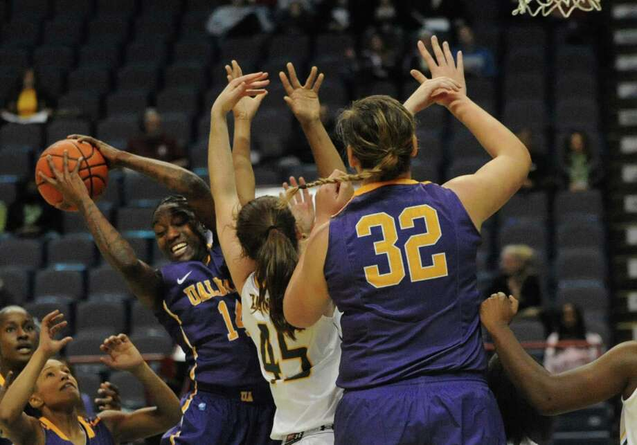 UAlbany's Tammy Phillip grabs a rebound during a basketball game against Siena at the Times Union Center  Friday, Nov. 8, 2013 in Albany, N.Y. (Lori Van Buren / Times Union) Photo: Lori Van Buren / 00024542A