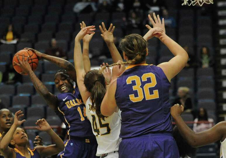 UAlbany's Tammy Phillip grabs a rebound during a basketball game against Siena at the Times Union Ce