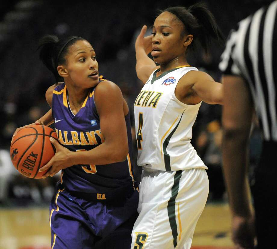UAlbany's Margarita Rosario is guarded by Siena's Emia Willingham during a basketball game at the Times Union Center  Friday, Nov. 8, 2013 in Albany, N.Y. (Lori Van Buren / Times Union) Photo: Lori Van Buren / 00024542A