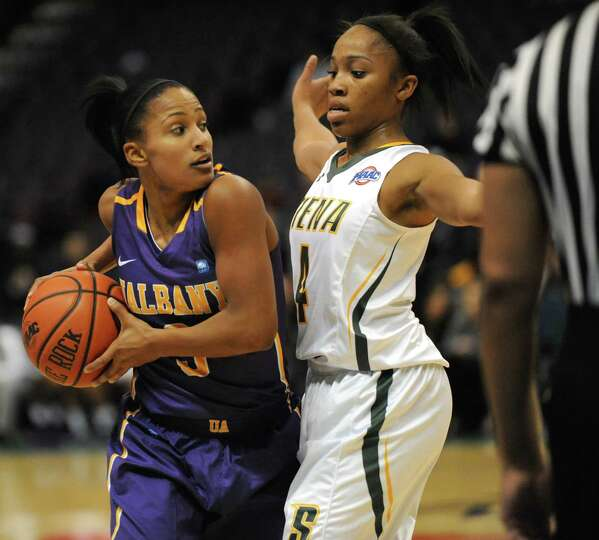 UAlbany's Margarita Rosario is guarded by Siena's Emia Willingham during a basketball game at the Ti