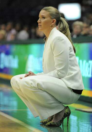 Siena head coach Ali Jaques watches closely from the sidelines during a basketball game against UAlb