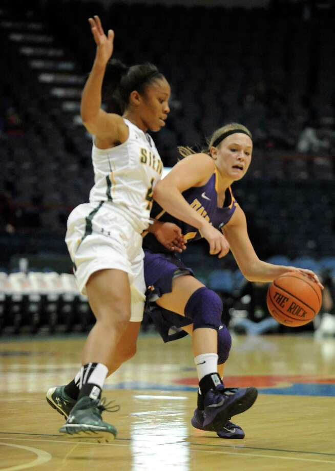 UAlbany's Sarah Royals is guarded by Siena's Emia Willingham during a basketball game at the Times Union Center  Friday, Nov. 8, 2013 in Albany, N.Y. (Lori Van Buren / Times Union) Photo: Lori Van Buren / 00024542A