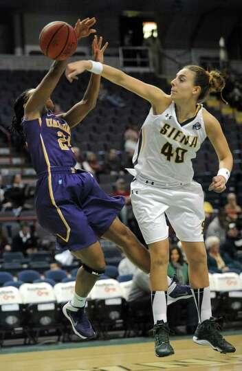 UAlbany's Keyontae Williams, left, has the ball knocked away by Siena's Clara Sole Anglada during a