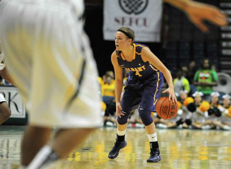 UAlbany's Sarah Royals looks for an open player during a basketball game against Siena at the Times