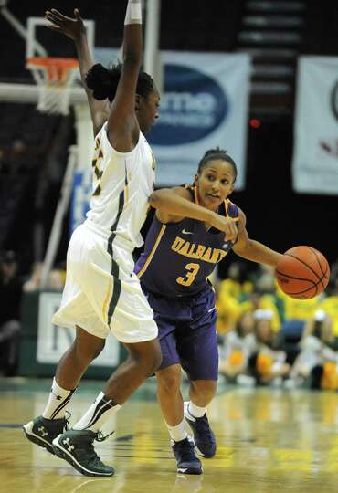 UAlbany's Margarita Rosario takes the ball up the court guarded by Siena's Tehresa Coles during a ba
