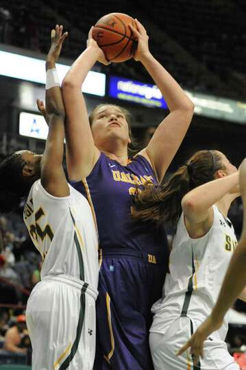 UAlbany's Megan Craig goes up for a basket as she is guarded by Siena's Tehresa Coles during a baske