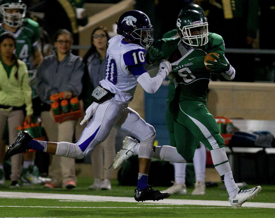 Ridge Point High School cornerback Jordan Tolbert, left, drives Stratford High School's Terrance Peters out of bounds during the fourth quarter of a football game at Darrell Tully Stadium, Friday, Nov. 8, 2013, in Houston. Stratford won 17-3. Photo: Cody Duty, Houston Chronicle / © 2013 Houston Chronicle