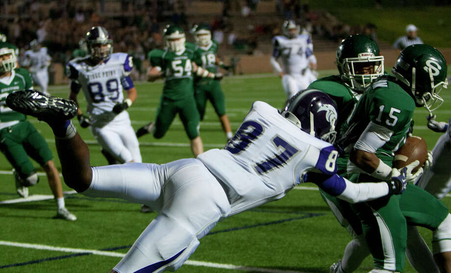 Stratford High School defensive back Brice Stevenson intercepts a pass for Ridge Point High School wide receiver Jonah Jordan near the end zone during the fourth quarter of a football game at Darrell Tully Stadium, Friday, Nov. 8, 2013, in Houston. Stratford scored on the drive helping them win 17-3. Photo: Cody Duty, Houston Chronicle / © 2013 Houston Chronicle