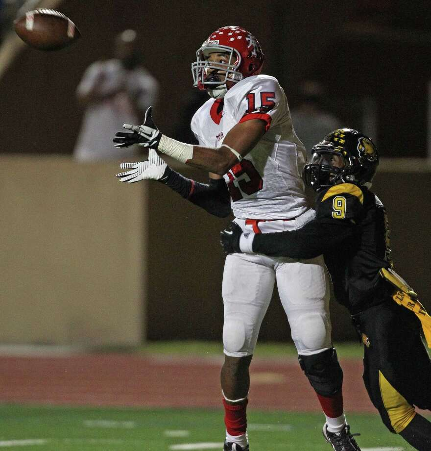 Alief Taylor's Romello Brooker, left, makes a reception as Hastings' Warren Howard defends during the first half of a high school football game, Friday, November 8, 2013 at Crump Stadium in Houston. Photo: Eric Christian Smith, For The Chronicle
