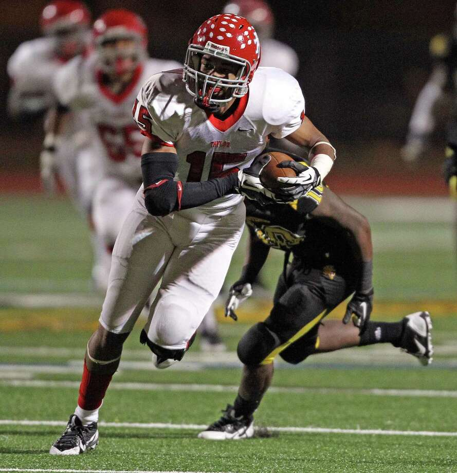 Alief Taylor's Romello Brooker runs the ball upfield after making a reception past Hastings' Devijea Kiser Carter during the first half of a high school football game, Friday, November 8, 2013 at Crump Stadium in Houston. Photo: Eric Christian Smith, For The Chronicle