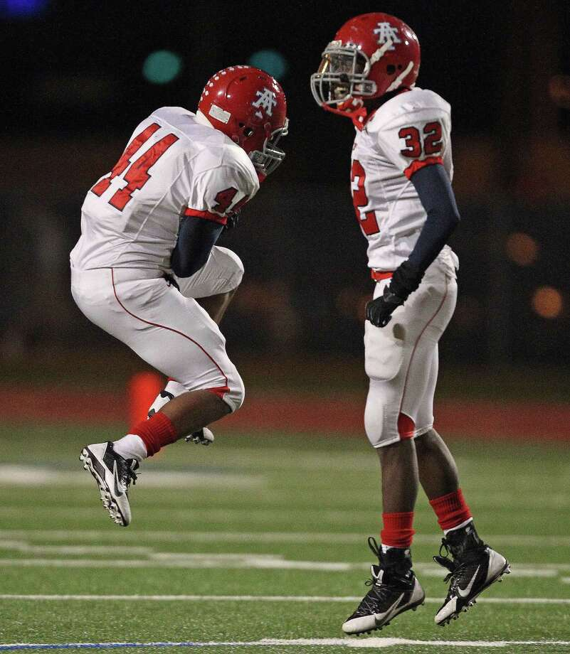Alieft Taylor's Michael Reynolds, right, and Aaron hall celebrate a fumble recovery during the first half of a high school football game against Hastings, Friday, November 8, 2013 at Crump Stadium in Houston. Photo: Eric Christian Smith, For The Chronicle